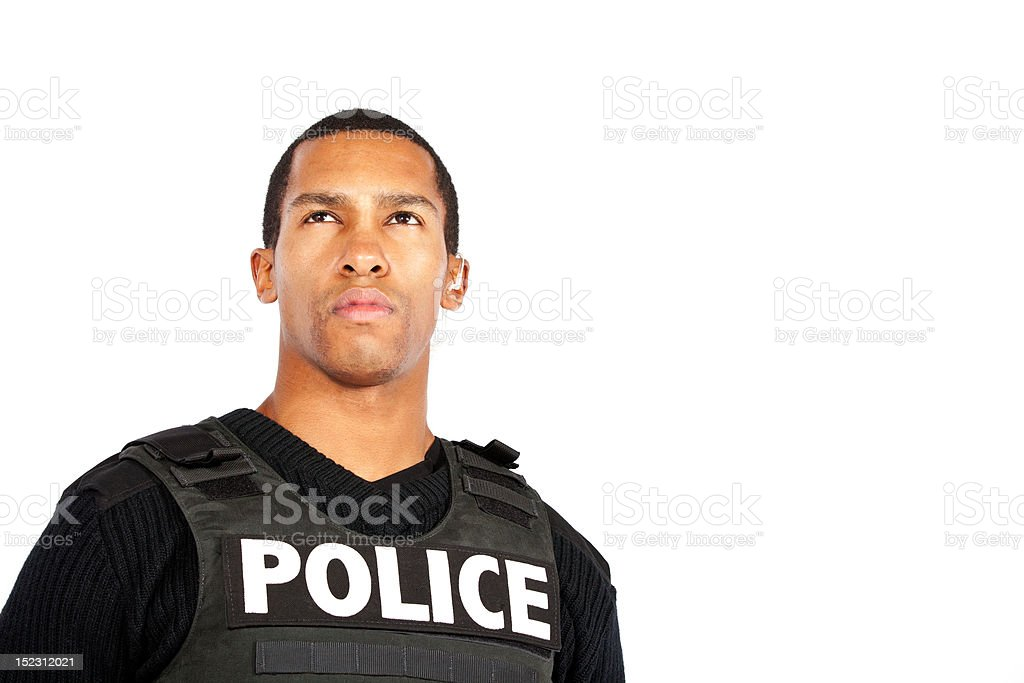 Young police officer watching stock photo