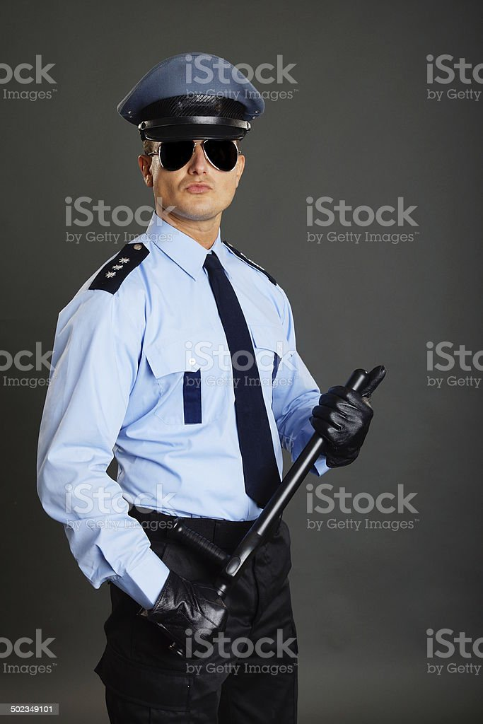 Young policeman in uniform royalty-free stock photo