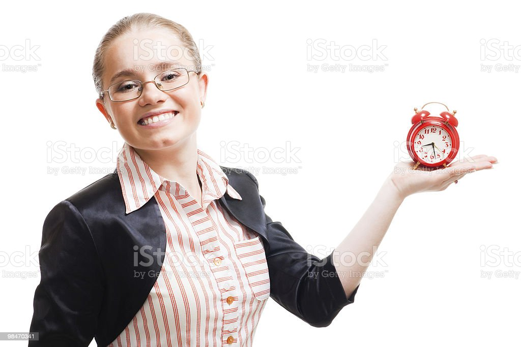 Young positive woman with alarm clock royalty-free stock photo