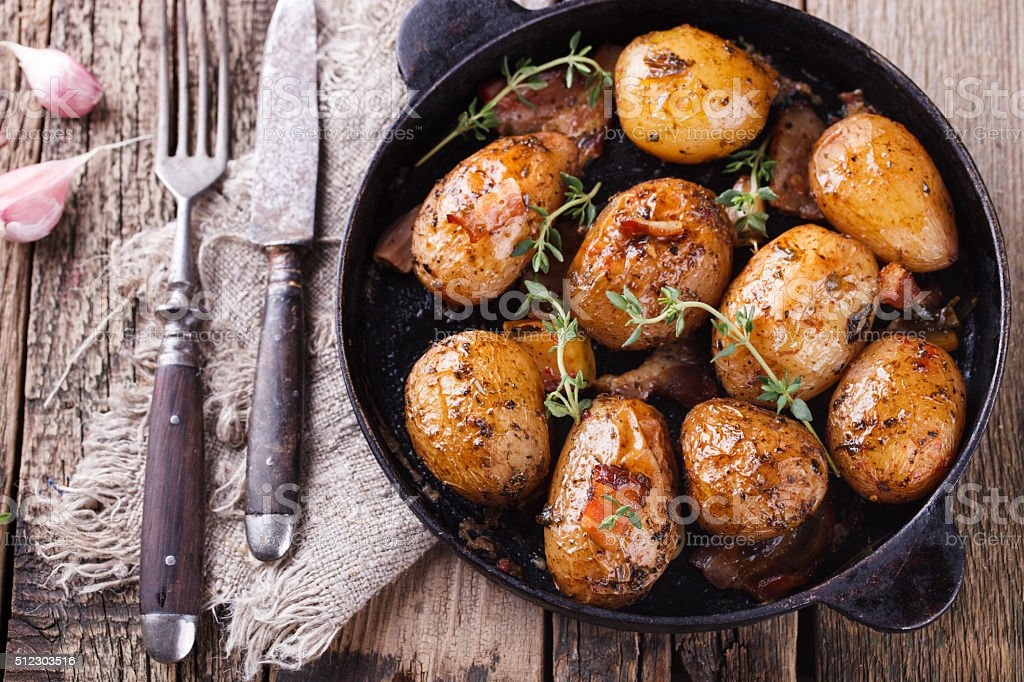 Young potatoes fried in a pan stock photo