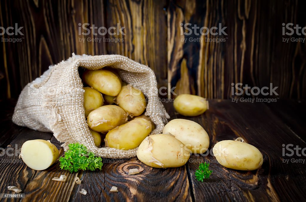 Young potatoes in a sack stock photo