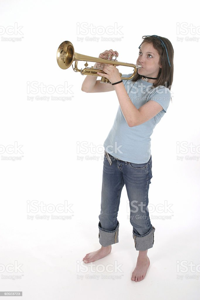Young Pre Teen Girl Playing Trumpet 2 royalty-free stock photo