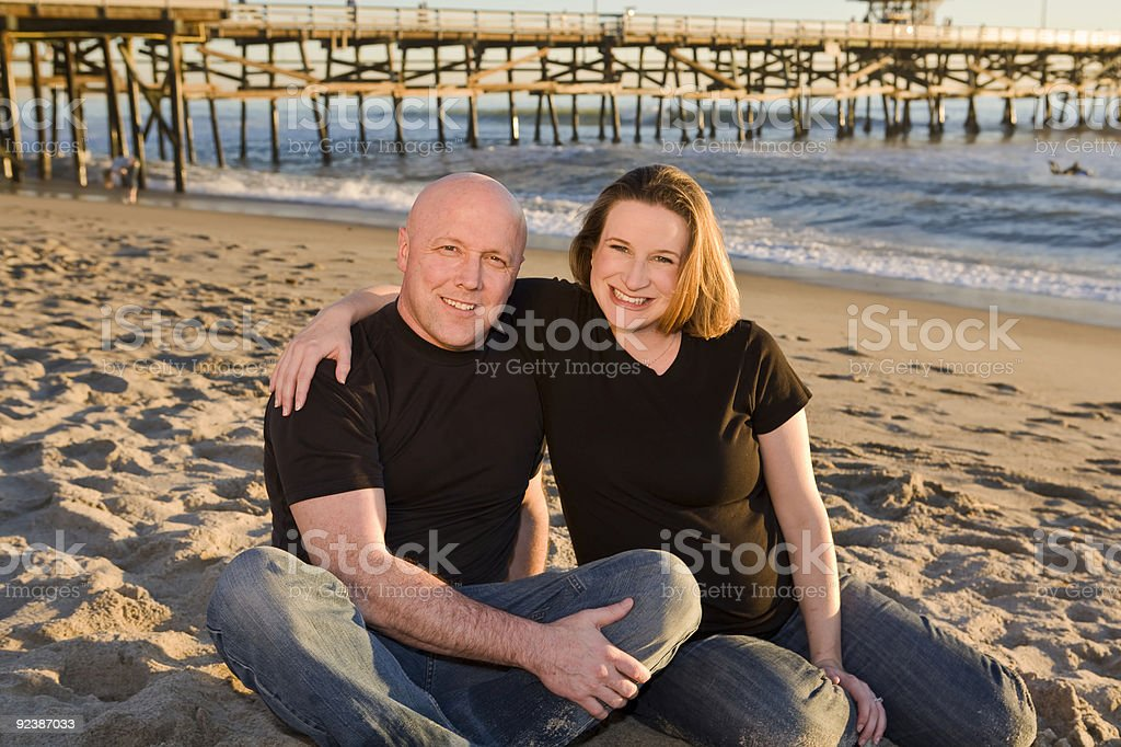Young Pregnant Couple on the Beach stock photo