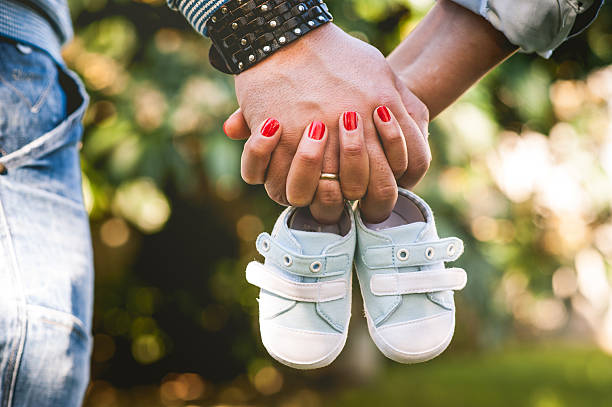 Young Pregnant Couple Portrait Outdoor stock photo
