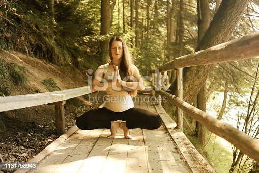 Woman Yoga. Relax in nature. Yoga woman meditatin. Healthy lifestyle concept