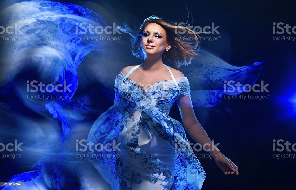 Young pregnant woman in fashionable dress stock photo