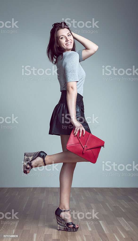 Young Pretty Brunette Girl with Red Handbag stock photo