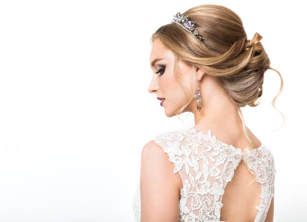 young pretty caucasian bride in wedding dress - bride stock photos and pictures