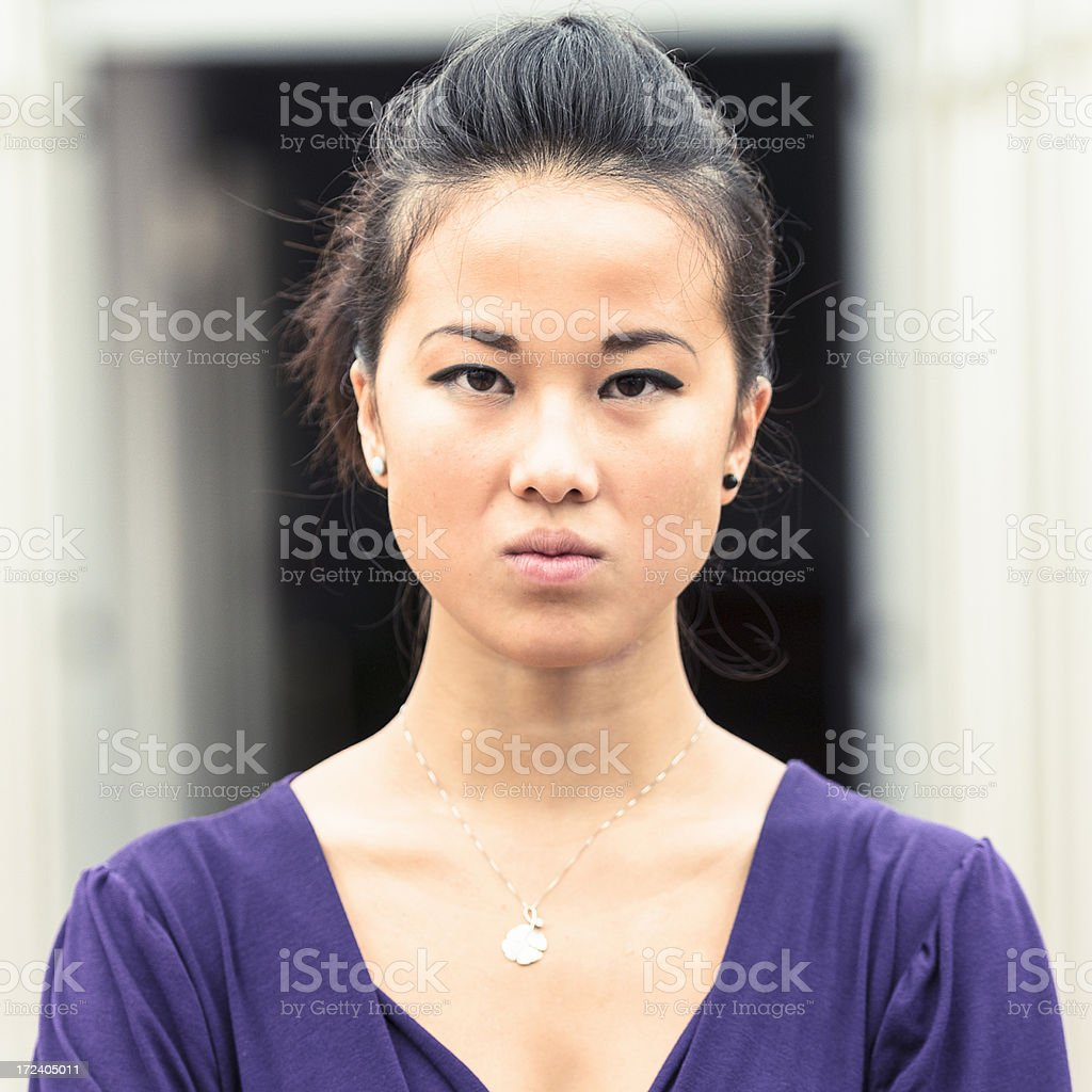 young pretty chinese girl on serious pose stock photo