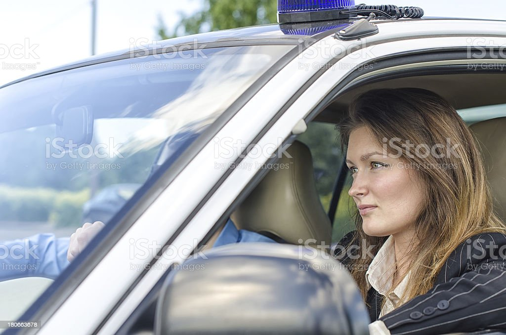 Young pretty female agent driving the car stock photo