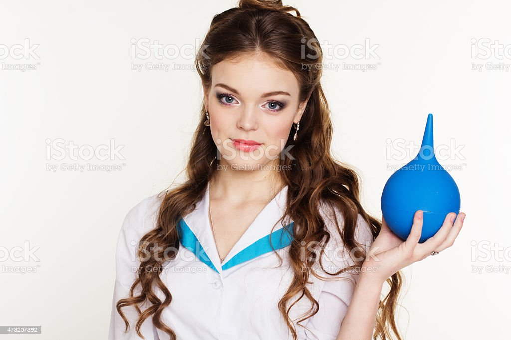 Young pretty girl nurse with blue squirt in hands stock photo