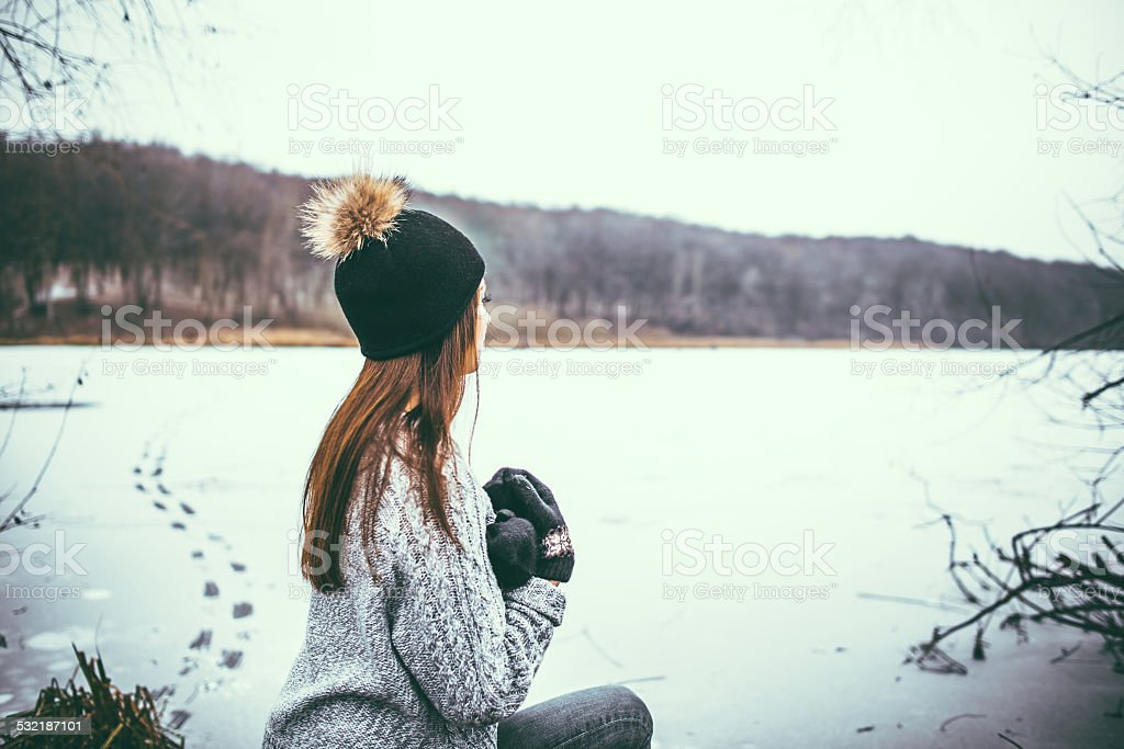 Young pretty girl outdoor in the forest stock photo