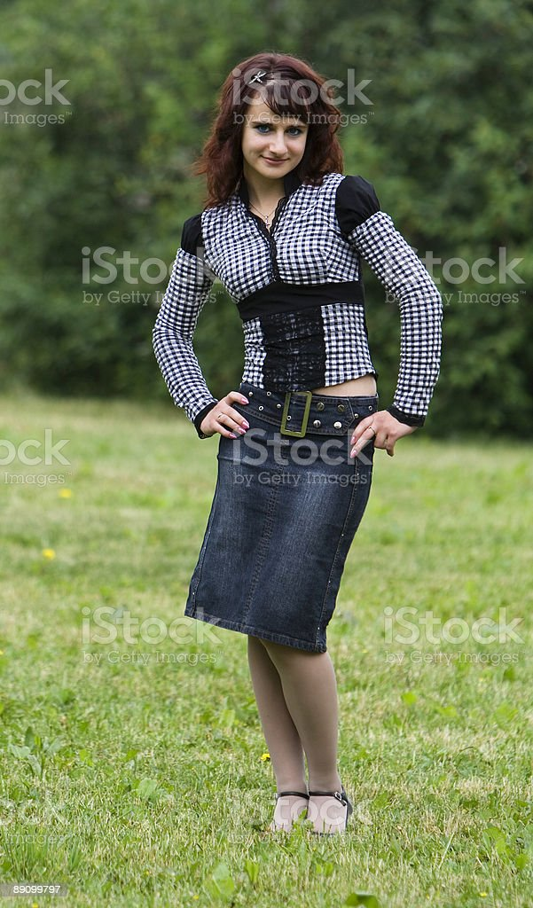 Young pretty girl posing outside royalty-free stock photo