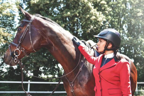 Young pretty jockey girl preparing horse for ride love horses picture id1166402197?b=1&k=6&m=1166402197&s=612x612&w=0&h=fbjgh0u1z yl7exkm6k  npqxbqb y5xpu7ilk7xb5y=