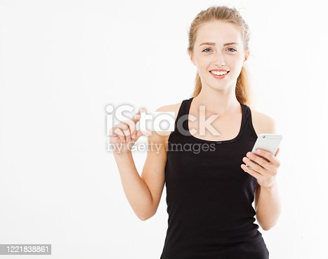 young pretty lady holding a phone and business card isolated on white