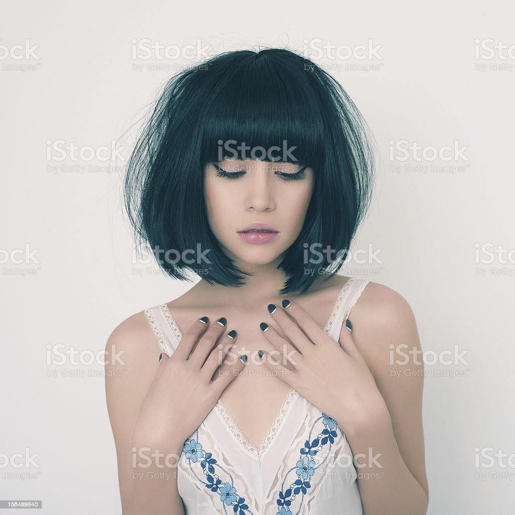 Young pretty lady with eyes closed and hands to her chest stock photo