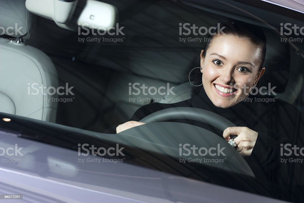 young pretty woman driving car royalty-free stock photo