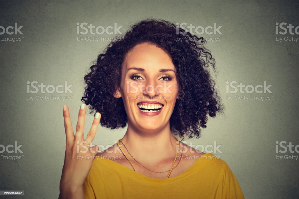 young pretty woman giving a three fingers sign gesture with hand stock photo