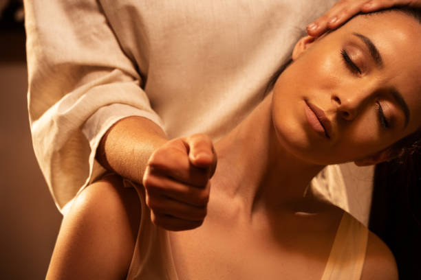 Young pretty woman has Thai massage. Close up of neck stretching. Concept of serene spa treatments. stock photo