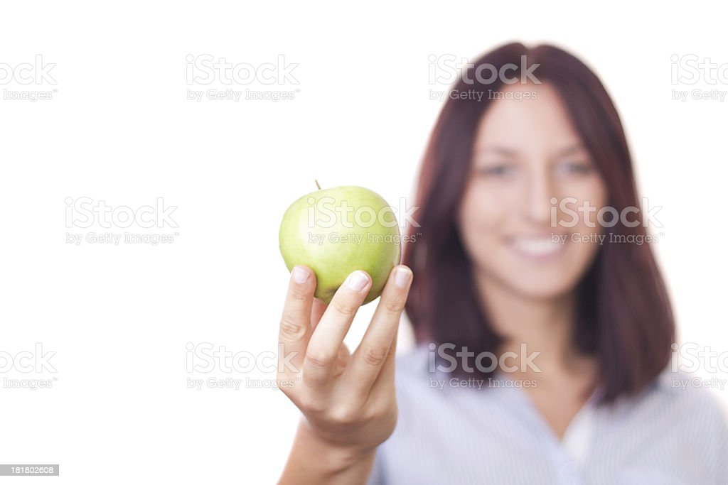 Young pretty woman holding green apple stock photo