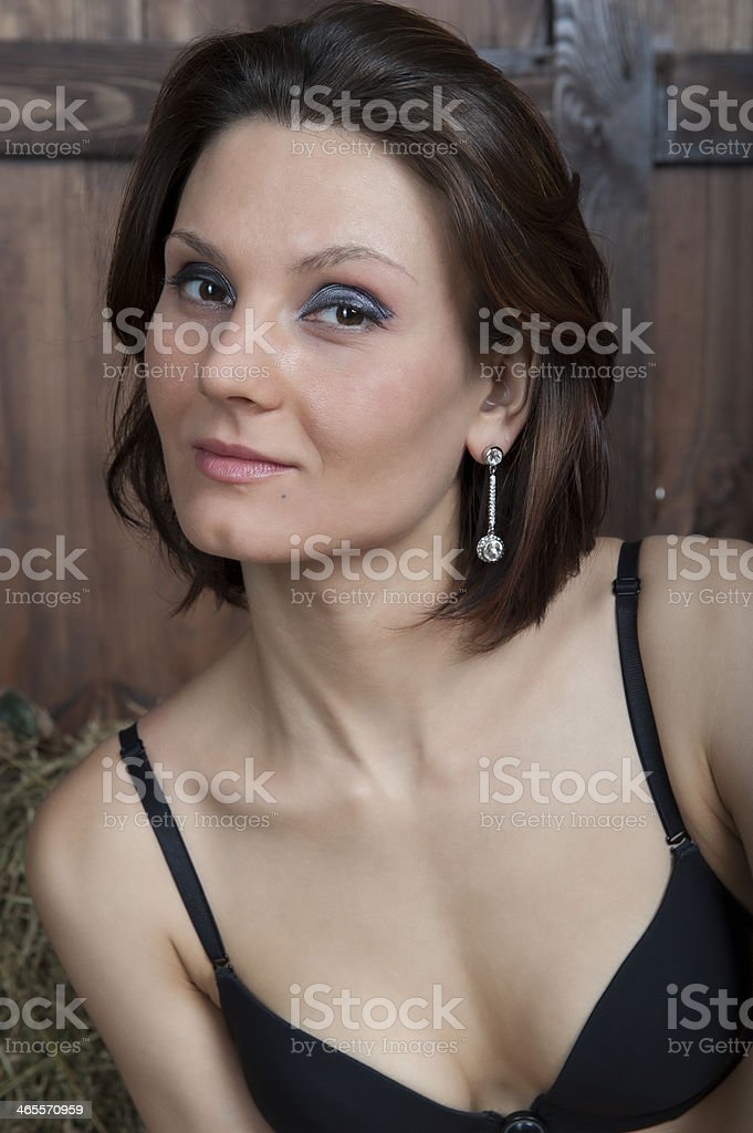 Young pretty woman in black lingerie stock photo