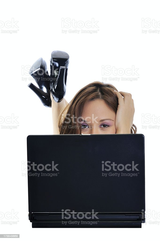 Young pretty woman in front a laptop royalty-free stock photo