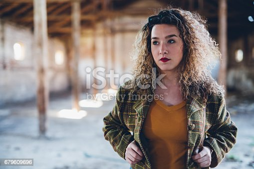 istock Young pretty woman in obsolete building 679609696