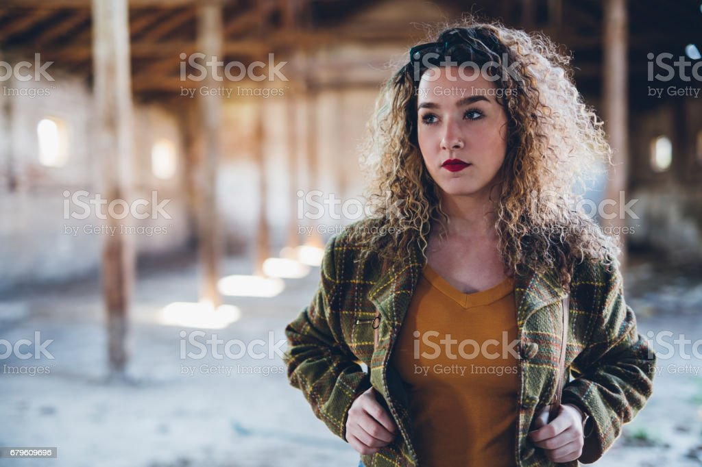 Young pretty woman in obsolete building stock photo