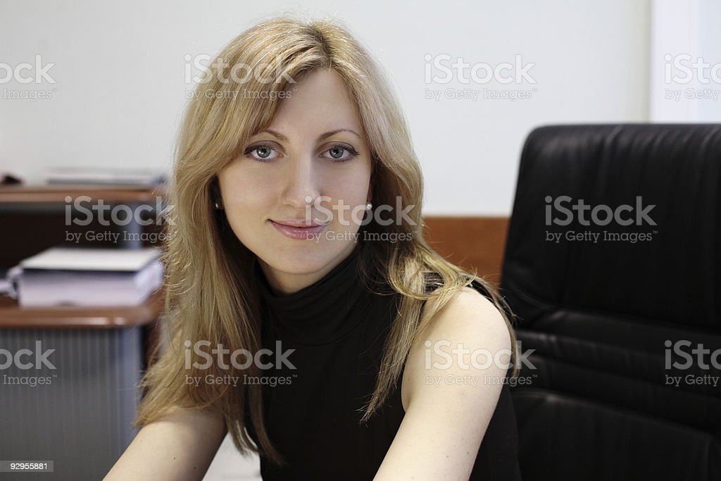 young pretty woman in office royalty-free stock photo