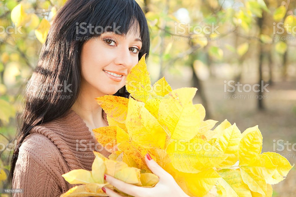 Young pretty woman in the autumn park royalty-free stock photo