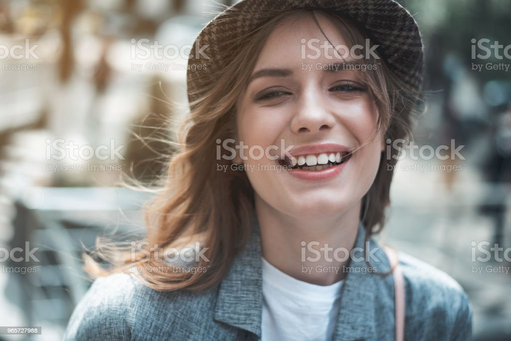 Young pretty woman smiling outdoors - Royalty-free Admiration Stock Photo