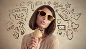 Young pretty woman thinking of her plans, eating icecream and having fun closeup face portrait and sketches overhead