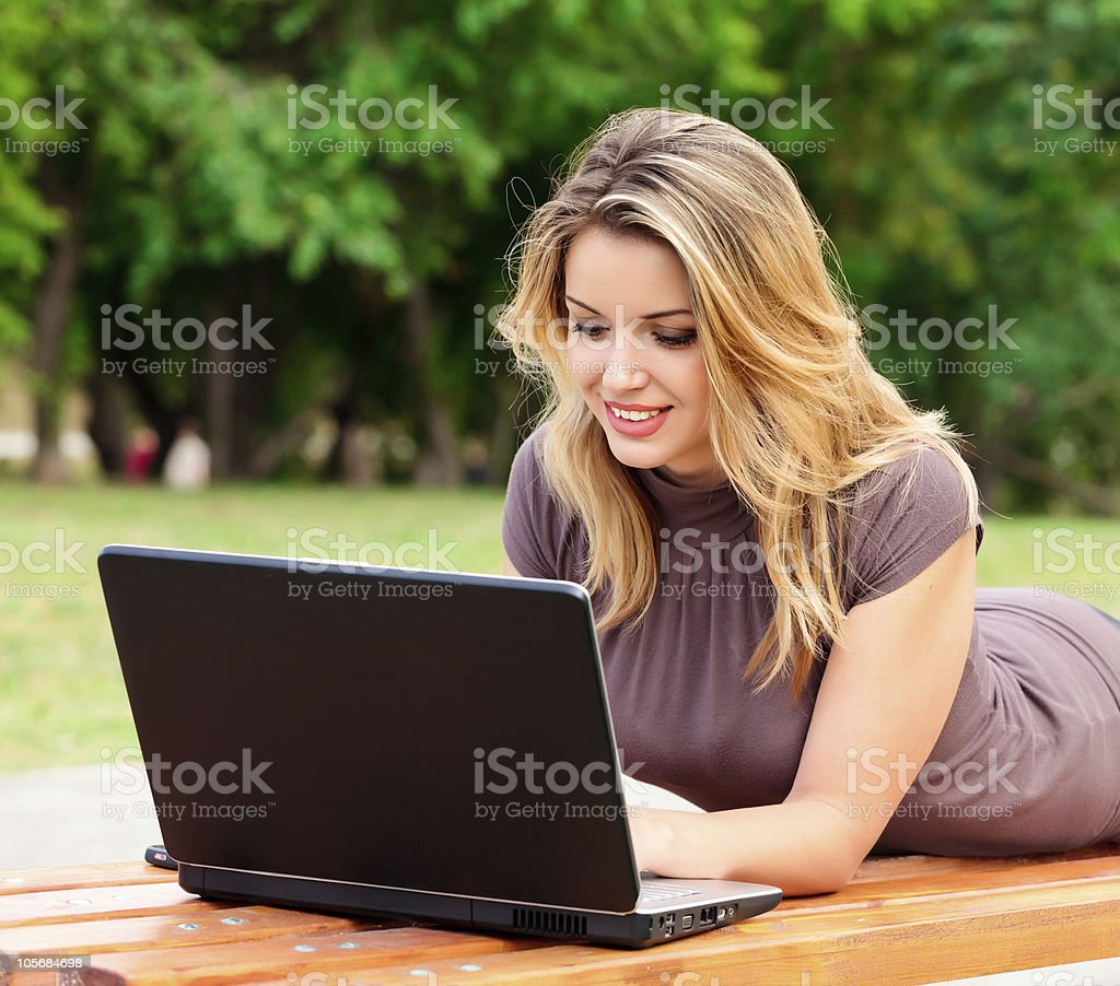 Young pretty woman with laptop royalty-free stock photo