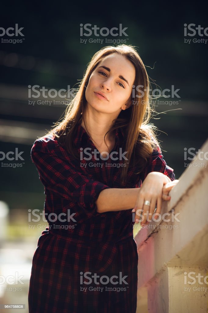 young pretty women with long windy hair in violet dress standing at stairs royalty-free stock photo
