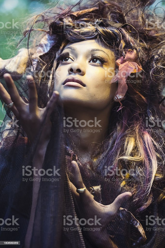 Young Priestess With Arms Raised stock photo