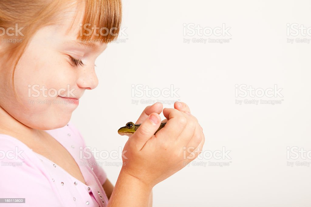 Young Princess Smiling at Frog, With Copy Space stock photo