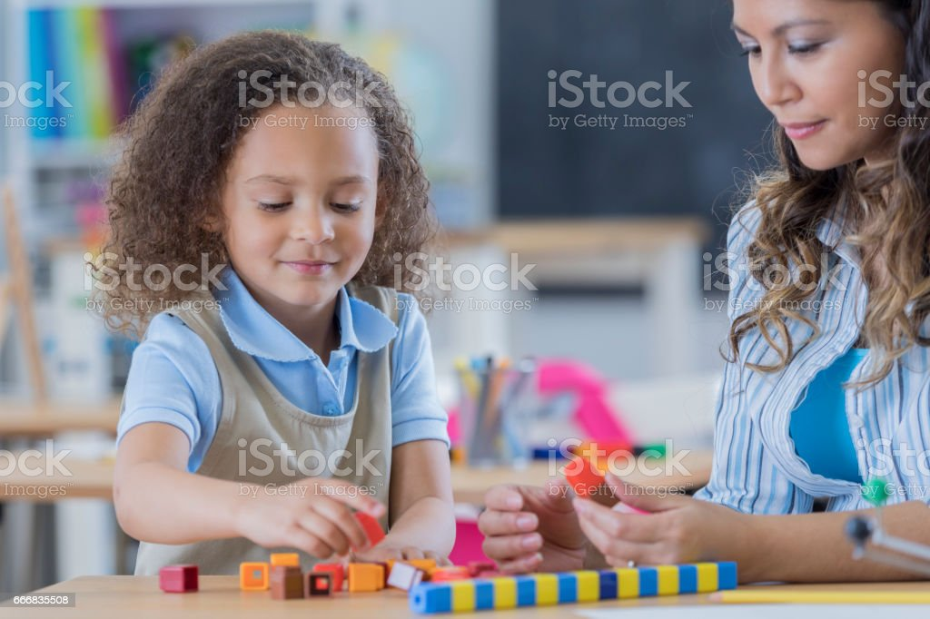 Young private schoolgirl in math class stock photo