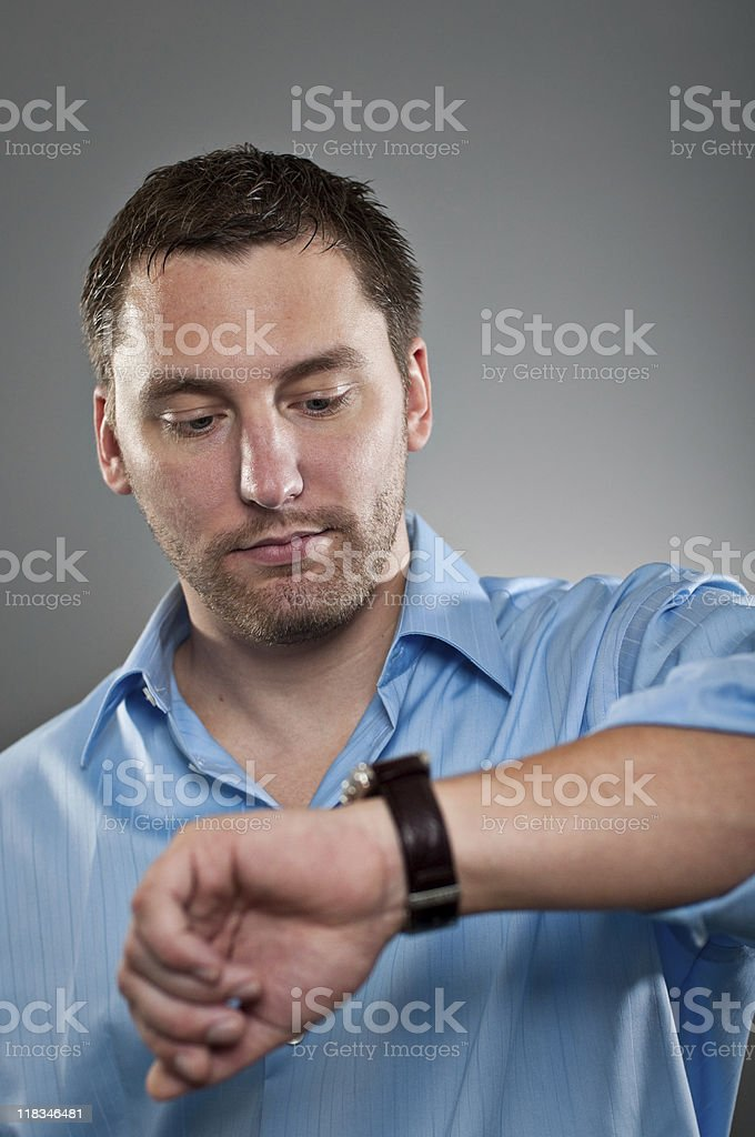 Young Professional Checking The Time royalty-free stock photo