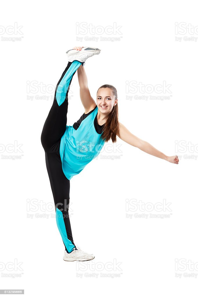 Young professional cheerleader  stands in vertical splits. stock photo