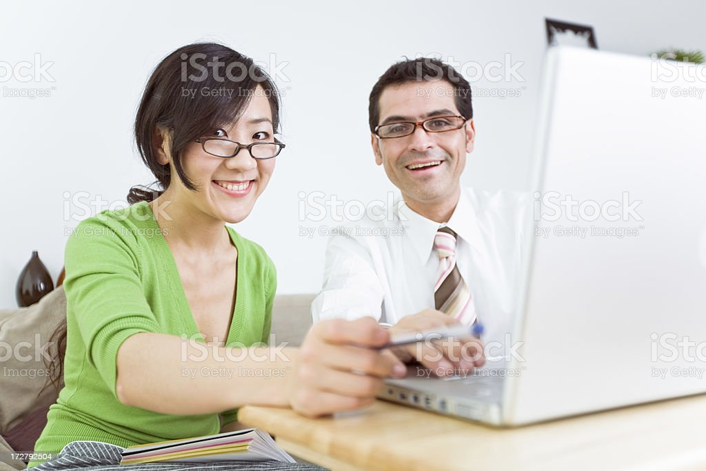 Young professional couple working together royalty-free stock photo