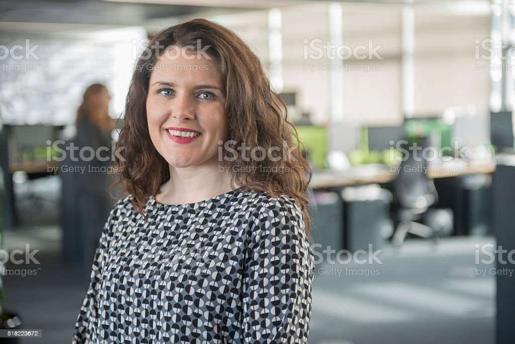 Young professional female in office stock photo