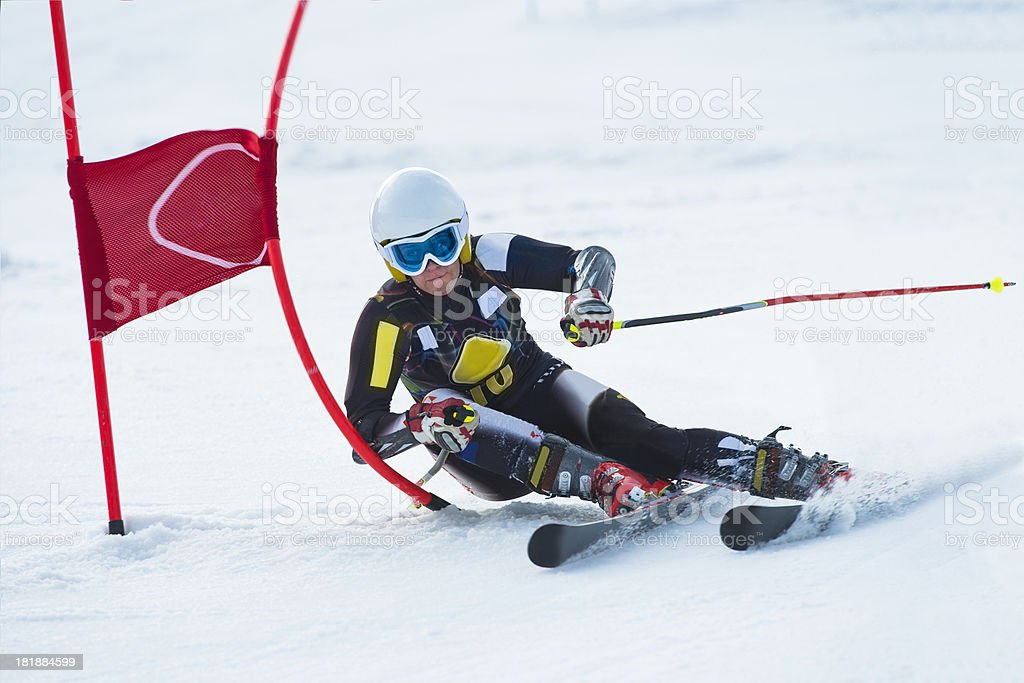 Young Professional Female Skier at Giant Slalom Race stock photo