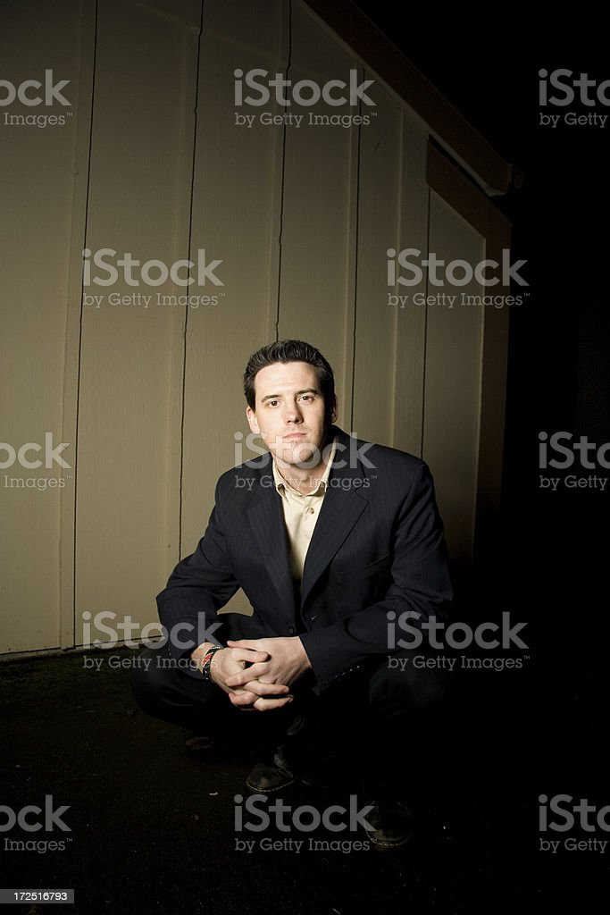 young professional man in the shadows stock photo
