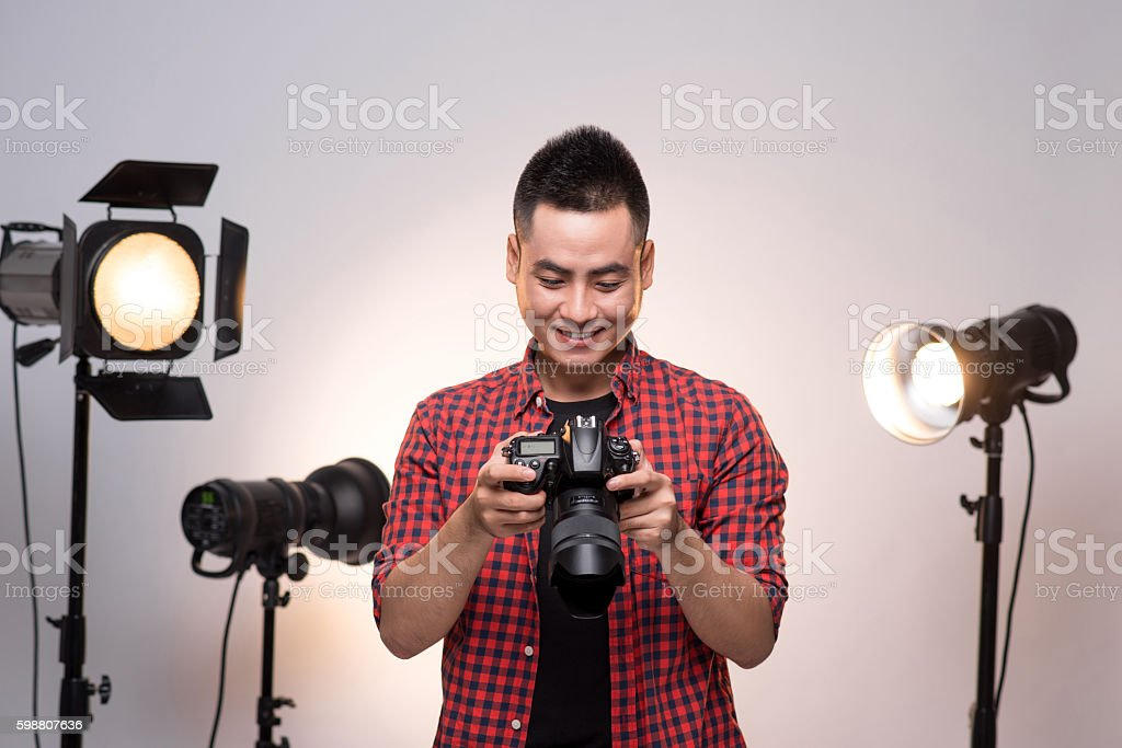 Young professional photographer stock photo