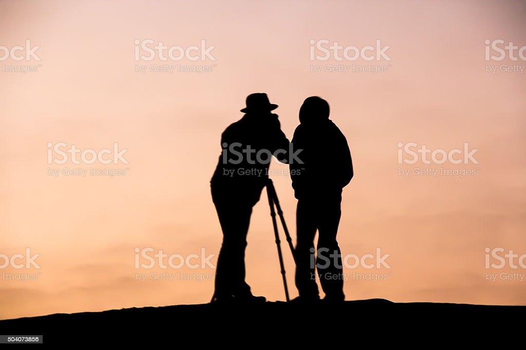 Young Professional Photographers on Sand Dunes of Dubai, UAE stock photo