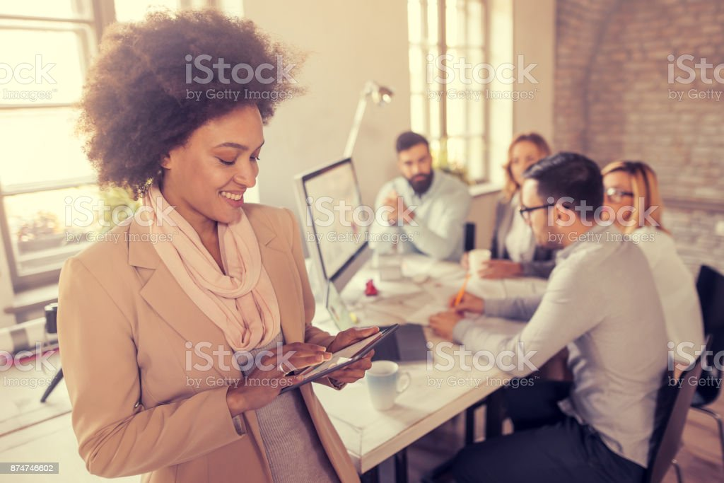 Young professional team.Young team of coworkers making great business discussion in modern office. stock photo