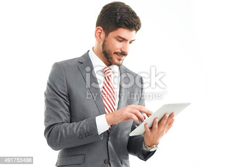 istock Young professional with digital tablet 491753496