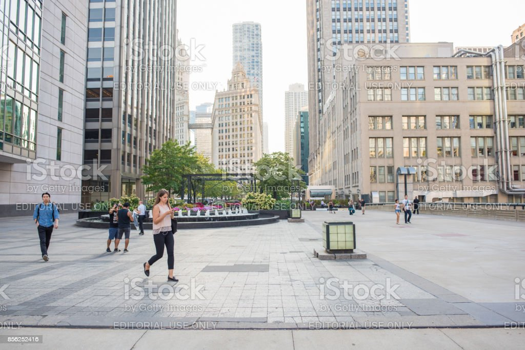 Young professional woman checking her phone downtown Chicago stock photo