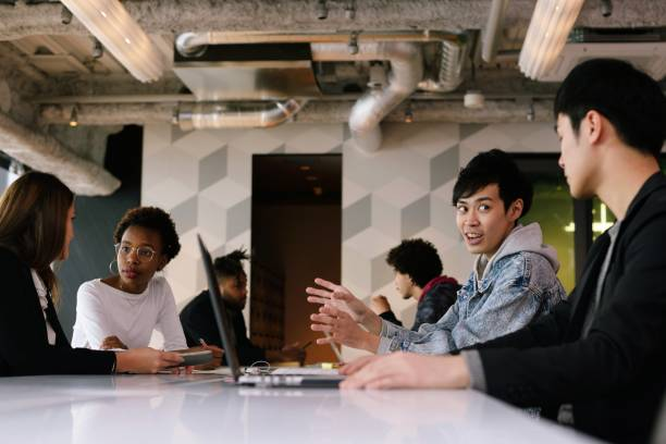 Young professionals at coworking space stock photo