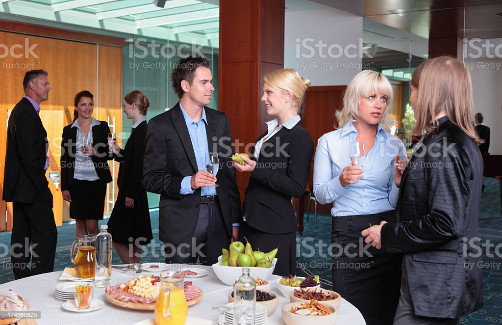 Young professionals in meeting with buffet in modern office stock photo